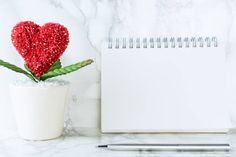 heart shaped flower with blank book page for valentines messege copy