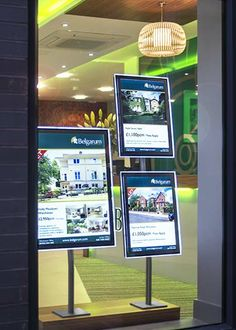 A picture paints a thousand words! Window displays with stainless steel and LED illuminated pockets, manufactured by Durleigh Displays. Walnut plinths complete the look and provide space for power supplies and cabling.