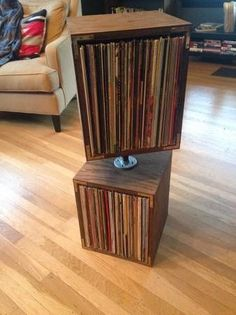 vinyl record storage solution; swivels but could make a library behind lounge?? not nec swivel but oh i dont know looks good