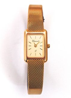 14 karat gold rectangular Charmont ladies' watch. From €3200 for €1599. See more at - http://www.megawatchoutlet.com/women/chamont.html