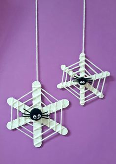 Kids will love making adorable Halloween crafts - like these hanging webs with pom pom spiders!