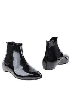 Perfect Flat Boots To Conquer Any Hill #refinery29 Le Stelle Ankle Boots, $83, available at Yoox.