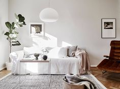 Love the cozy and warm brown tints in this home. The old wooden doors and floors are beautifully combined with the ocher armchair, white furniture and green plants. Decoration Inspiration, Interior Inspiration, Doors And Floors, Old Wooden Doors, White Couches, Swedish House, Scandinavian Home, White Furniture, Living Room Inspiration
