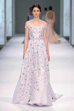 Pale lavender silk organza gown with sheer neckline and floral silk thread-work embroidery.
