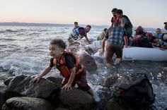 A group of Syrians arrives on Lesvos after sailing on an inflatable raft from Turkey.