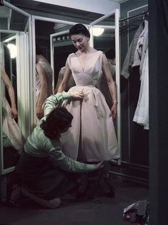 1950s Christian Dior pink tea-length dress being fitted on model Alla