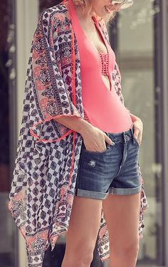 Too cute! A sheer tie-front cover-up is cut to float around the figure in an airy kimono-sleeve silhouette finished with color-pop crochet trim.