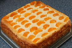 Leckerer und einfacher Käsekuchen - Rezept mit Mandarinen und Mandel-Boden