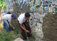 plastic bottle building. SO COOL.