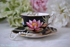 ON SALE Aynsley Black Lotus Teacup And Saucer by TheTeacupAttic