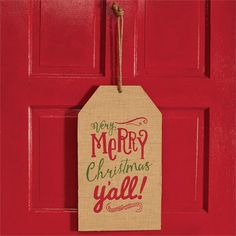 """Double-sided burlap tag features """"VERY MERRY CHRISTMAS Y'ALL"""" greeting printed on front and chalkboard area for personalization on reverse side.  Tag hangs from rope on door or wall."""