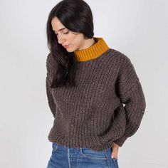 Pure Wool Women´s jumper crafted in Spain. Undyed Spanish wool with a touch of ochre in the neckline. Such a cozy knit, perfect to be worn everyday