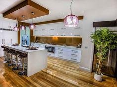 Classic open plan kitchen design using floorboards - Kitchen Photo 16996197