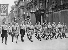 Adolf Hitler, Hermann Goering and others marching in Munich, November 1937.