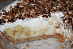 Banana Pie with Shortbread Cookie Crust - Banana slices, layered in a cream cheese filling on a shortbread pie crust, covered in whipped topping, chopped pecans and chocolate sauce.
