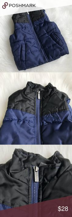 """Kenneth Cole Toddler Boys Winter Vest Puffer Coat Kenneth Cole Toddler Boys Winter Vest Puffer Coat in Navy blue & black! Love this adorable vest to keep baby nice & warm & still look cute & fashionable! Zipper & 2 front Pockets. Size 24 months. Poly. 14"""" Long & 13"""" across. Previously loved. Has imperfection on back right under the arm area. CP3583012618 Kenneth Cole Reaction Jackets & Coats Vests"""