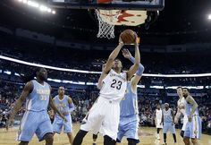 Description of . New Orleans Pelicans forward Anthony Davis (23) goes to the basket in front of Denver Nuggets center Jusuf Nurkic and forward Kenneth Faried (35) during the first half of an NBA basketball game in New Orleans, Wednesday, Jan. 28, 2015. (AP Photo/Gerald Herbert)