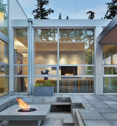 Ready for autumn with this contemporary firepit and home by Roberts Group Custom Builder.