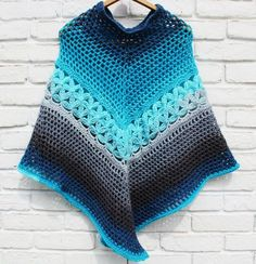 Free crochet poncho pattern, crochet pattern with mandala caron yarn cake. Easy to follow poncho pattern with link to video tutorial!