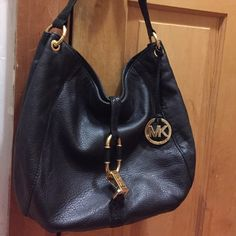 Michael Kors Hobo Style Purse Beautiful black leather with gold hardware purse. Classic design. Many pockets including on back, inside zipper and four other pockets inside for organization (all fit iphone6).  Trim on purse is a shimmery, black snack-skin print. Michael Kors Bags Shoulder Bags