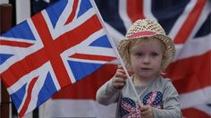 A young girl shows her support for the Great Britain team. (AP Photo/Ng Han Guan)