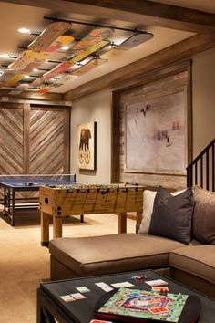 modest maintenance fun ceiling idea maybe with water skis or wake boards