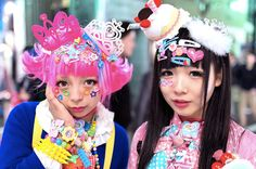 Two colorfully dressed Harajuku decora wearing countless colorful accessories including items from Hello Kitty, and the Care Bears. Japanese Fashion Trends, Japanese Street Fashion, Tokyo Fashion, Harajuku Fashion, Kawaii Fashion, Lolita Fashion, Pop Fashion, Harajuku Style, Katy Perry News