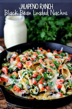 Jalapeno Ranch Black Bean Loaded Nachos - loaded with fresh ingredients and spicy jalapeno ranch, these come together in less than 20 minutes!