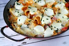 Recipe for Skillet Lasagna- an easy, family-friendly, delicious dinner recipe.  Not quite as easy my recipe that doesn't precook the noodle but sounds pretty easy.