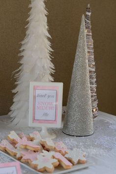 Gorgeous decorations and cookies at a Winter Onederland birthday party! See more party planning ideas at CatchMyParty.com!