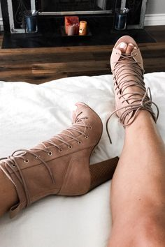Ahh-maxing booties that tie all the way. Man made suede material in the perfect nude color with a touch of pink. This pair is a must have for the summer to fall transition with the closed heel and ope
