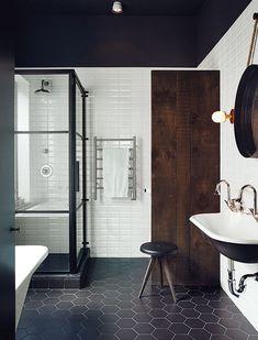 Subway tiles on wall, Octagon Black Tile on Floor, Kohler Sink, Black and Glass shower doors