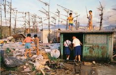 kids on the roofs early evening  From the book: City of Darkness  - Life in Kowloon Walled city