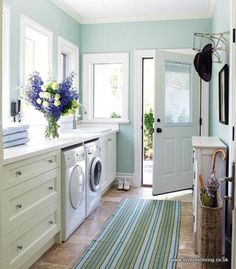 How to Keep a Family Home Clean [Yeah, I don't care for that part as much as the GORGEOUS colors and lighting in this room -- Wouldn't mind doing laundry in here!]