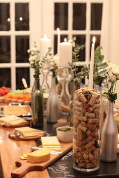 wine bottles spray painted silver, white candles, babys breath, wine corks, cheese paddle, chalkboard runner