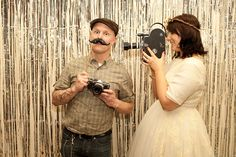 LOVE the photobooth with props idea for a wedding