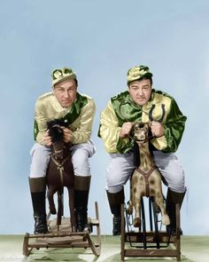 A vintage press shot of comic legends Bud Abbott and Lou Costello riding rocking horses for the1943 comedy classic, IT AIN'T HAY!