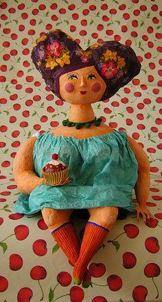 papier mache art doll sculpture.
