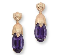 A PAIR OF AMETHYST EAR PENDANTS, BY BUCCELLATI  Each set with an oval-shaped amethyst, to the 18k reeded gold surmount, 4.2 cm long