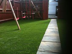 artificial grass and swing equipment in garden