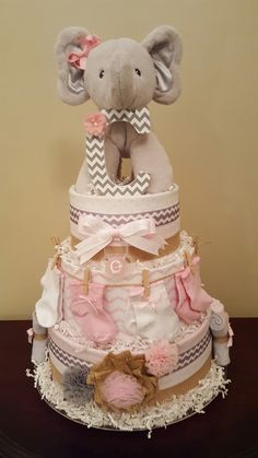 Pink and gray elephant diaper cake! it\'s a girl! Baby shower centerpiece gift.  I love the sock line! Check out my Facebook page Simply Showers for more pics and orders.