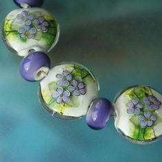 Violets - Handmade Lampwork Beads (SRA). $63.00, via Etsy.