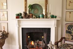 antique blue-green ginger jars, nice mantel styling, tapestry chair, symmetrical art flanking the fireplace, big mirror