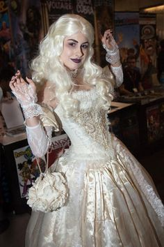 Burton's version brings a new character: the White Queen. Although her sister usurped her, we say you'll rule any Halloween party in this elegant attire.