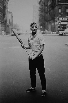 Diane Arbus ~ Teenager With a Baseball Bat, NYC 1962