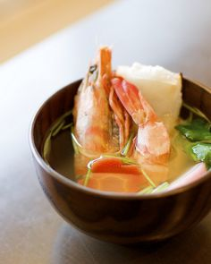 Japanese food -Ozoni- : rice cakes boiled in vegetable soup.