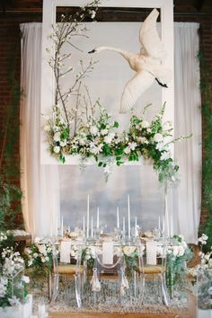 Dramatic White and Green Botanical Head Table at The Cream Event...would love to design this for someone's wedding!!! Everyone does the same thing these days, it's so boring and unoriginal. this design is so creative