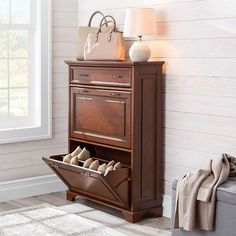 Shoe storage doesnt have to be a boring rack. Use a shoe storage cabinet that looks great. Its a great space-saving solution.