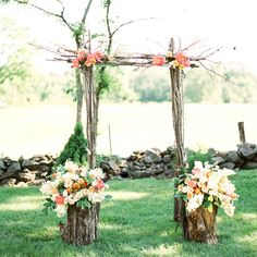 Simple ceremony arch made of tree branches and fresh blooms | Sweet Tea Photography | Flowers: Country Way