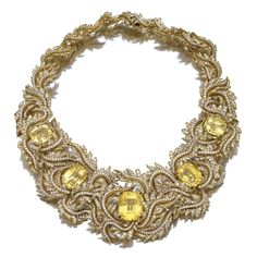 Impressive Yellow sapphire and diamond necklace The collar of scroll foliate design set with brilliant-cut diamonds, decorated to the front with cushion-shaped yellow sapphires, mounted in yellow gold